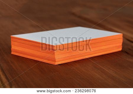 A Stack Of Blank Layered Business Cards With Painted Edges, On A Dark Background, With A Shallow Dep