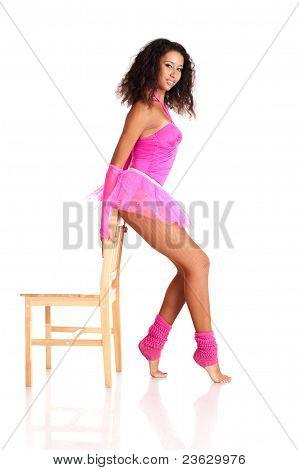 Dancer Black Girl By The Chair In Ballet Tutu