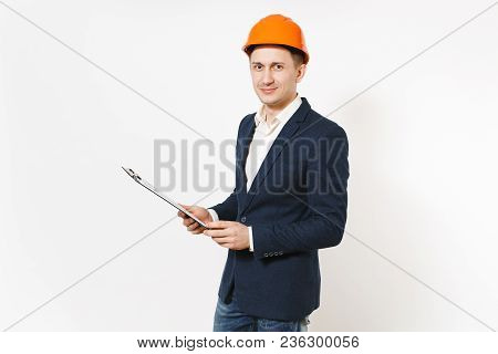 Young Handsome Successful Businessman In Dark Suit, Protective Construction Helmet Holding Clipboard