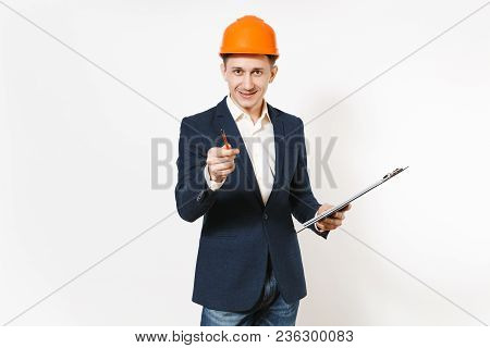 Young Smiling Businessman In Dark Suit, Protective Construction Helmet Holding Clipboard With Papers