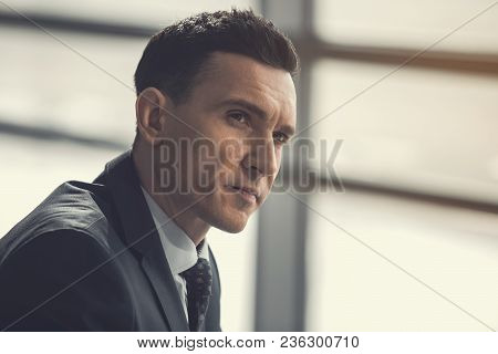 Portrait Of Employer Expressing Pensiveness While Locating Indoor. Contemplative Worker At Job Conce
