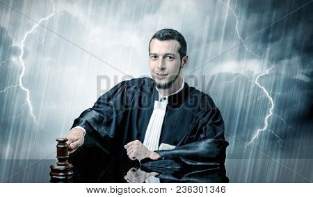 Young handsome judge with stormy wallpaper