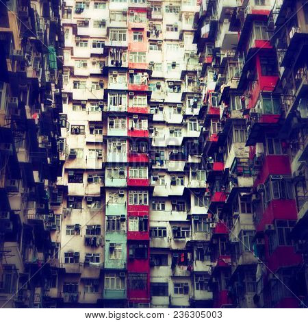 Hong Kong - October 2017: Colourful densely populated residential building.