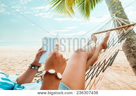 Leisure In Summer - Beautiful Tanned Of Sexy Women. Sunbathe Relax And Reading A Book On Hammock At