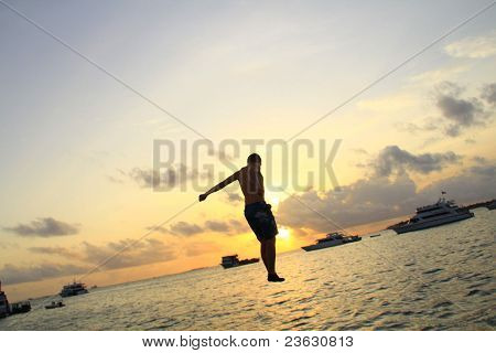 man jumping in the sunset