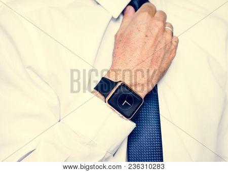 Hand with smartwatch adjust necktie