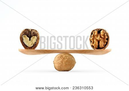 Concept Of Balance Between Heart And Brain Illustrated With Walnuts