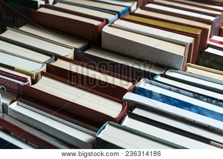 Many Books In A Bookstore Or Library On Wooden Background With Copy Space
