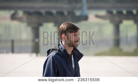 Bearded Man Looks Around In The City Street. Age Of Forty Years.