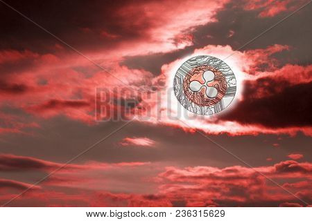 Sunset Ripple. The Fall Of Cryptocurrency Xrp. Coin Ripple Instead Of The Sun. Red Sunset With Dark