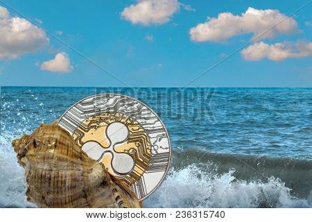 Shell With A Golden Ripple Coin On The Background Of Sea Waves And The Ocean. Find Treasure Xrp. Vac