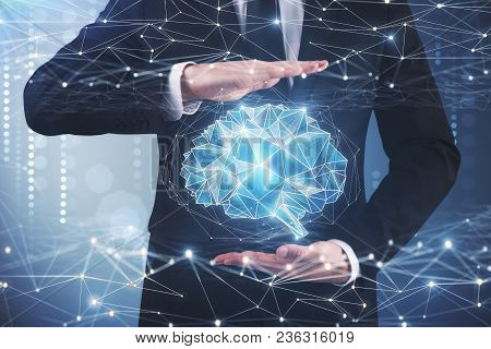 Businessman Holding Digital Polygonal Brain On Blurry Background. Artificial Intelligence And Future