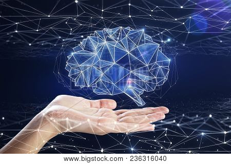 Hand Holding Digital Polygonal Brain On Blue Background. Artificial Intelligence And Medicine Concep