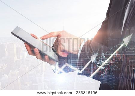 Businessman Hands Using Touchpad On Abstract City Background With Daylight. Technology, Network And