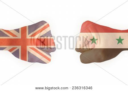 Two Fists With The Flag Of Syria And The United Kingdom Collided With Each Other, Ready For Battle I
