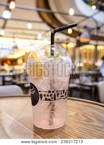 Cold Drink Of Lychee Lamon Juices With Soda And Ice On The Table In The Restaurant (seclective Focus