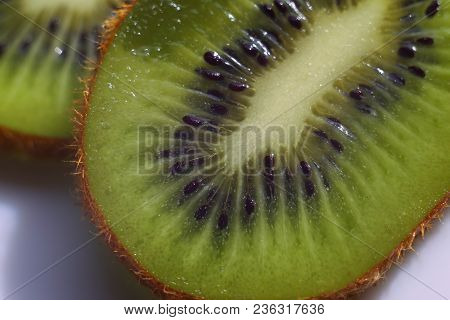 Fruit In Macro. Top View. Fresh Fruit. Kiwi Fruit On White Plate. Kiwi Collection. Juicy Fruit