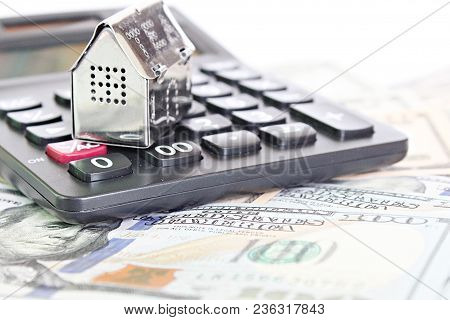 Business, Finance, Saving Money, Property Ladder Or Mortgage Loan Concept : House Model, Calculator