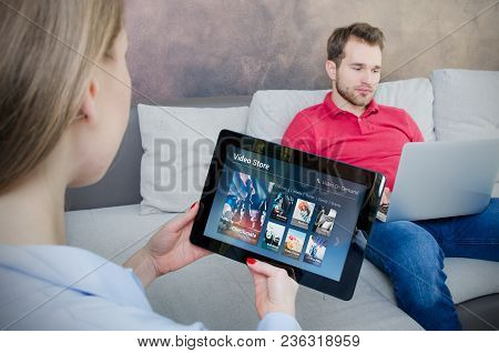Woman Using Digital Tablet For Watching Movie On Vod Service. Video On Demand Television Internet St
