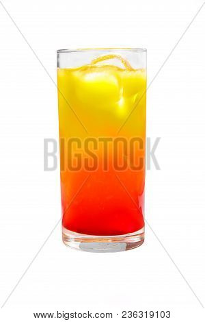 A multicolored, two-layered opaque cocktail in a tall glass with ice cubes, the taste of tomato, pineapple, and orange. Side view. Isolated white background. Drink for the menu restaurant, bar, cafe poster