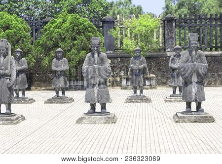 Stone statues of people in Imperial Minh Mang Tomb of the Nguygen dynasty in Hue, Vietnam. UNESCO world heritage site