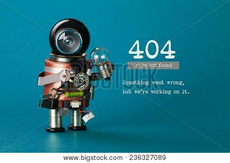 404 Error Web Page Not Found. Futuristic Robotic Toy Mechanism, Black Helmet Head, Light Bulb In Han