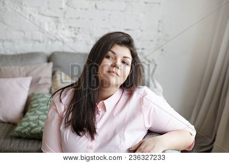 Close Up Of Attractive Chubby Girl In Her Twenties Resting At Home After She Finished Doing Housewor