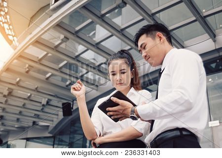 Business People Standing Front Company Working On Digital Tablet And Analysis Chart Report Together.