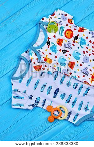 Boy And Girl Cotton Bodysuits. New Baby Cotton Brand Jumpsuits And Accessory, Top View.