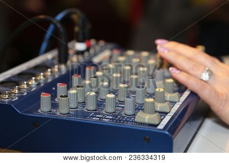 Dj Mixer Close Up While He Is Mixing. Concept About Party, Music, Fun And People. Woman Hand On A So