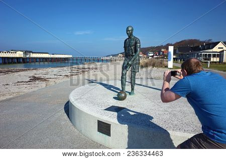 Helsingborg, Sweden - 14 April, 2018: Man photographing sculpture of Henrik Larsson, He played with Helsingborg, Celtic, Barcelona and Man United football teams in his career