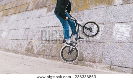 Bmx Rider Does A Wall Ride Around A Curved Wall. Bmx Freestyle. Stunts On Bmx Bike. The Bmx Rider Ri