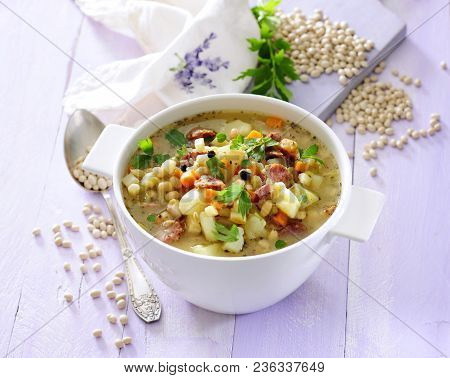 Minestrone Vegetable Soup With Soybean Protein Sprinkled With Fresh Lovage.