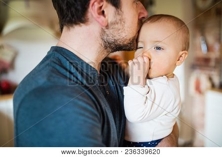 Unrecognizable Father With A Baby Girl At Home. Paternity Leave.