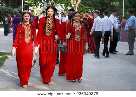 Ashgabat, Turkmenistan - May 25, 2017: Group Of Smiling Female Students In Red National Dresses With