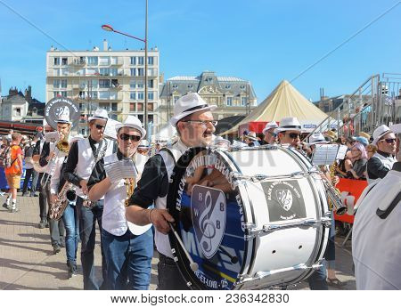Le Mans, France - June 16, 2017:orchestra With Various Musical Instruments Marching Band During Para