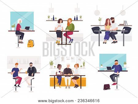 Set Of Men And Women Sitting At Cafe Or Restaurant Tables - Working On Laptop, Talking To Each Other