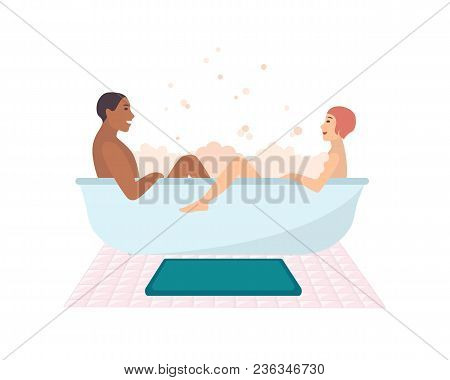 Young Naked Couple Sitting In Bathtub Full Of Soap Foam Isolated On White Background. Happy Smiling