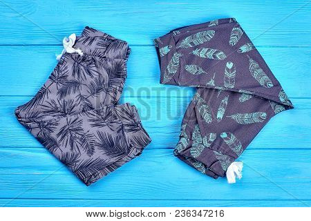 Toddlers New Trendy Cotton Outfit. Patterned Cotton Trousers For Kids Folded On Blue Background. Tod