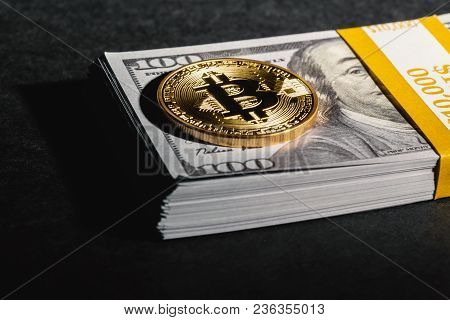 Bitcoin Cryptocurrency Coin With Usd Cash On A Dark Background