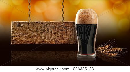 Dark Beer On The Dark Floor, Signboard Of Wheat And Old Board