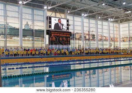 ST. PETERSBURG, RUSSIA - APRIL 11, 2018: Olympic champion Vladimir Salnikov during opening ceremony of All-Russian Swimming Competitions Merry Dolphin. The competitions was founded in 1965