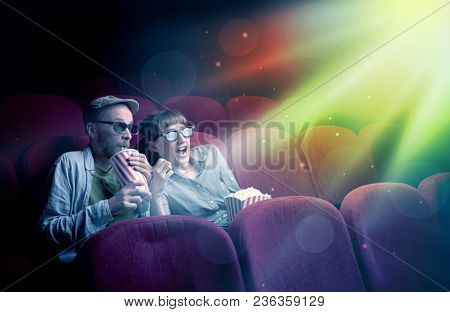 Teenager couple cuddling and watching the climax part of the movie