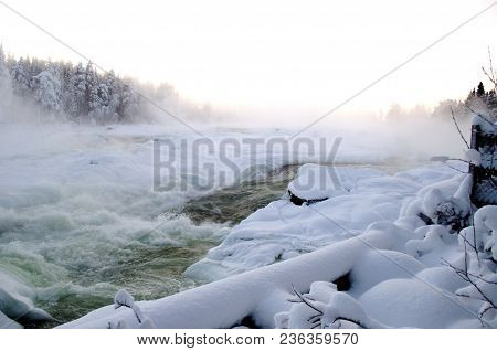 Storforsen Waterfall In The North Of Scandinavia In Winter