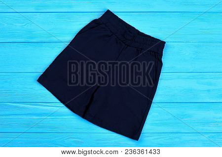 Dark Blue Cotton Shorts For Baby-boy. Textile Short Pants For Little Boys On Blue Wooden Background.