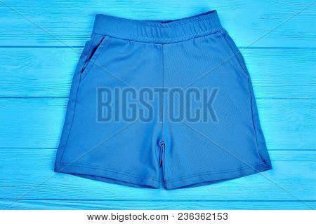 Blue Cotton Pocket Shorts For Kids. Little Boys Or Girls Textile Sport Shorts, Top View. Organic Cas
