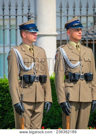 Warsaw, Poland - June 29, 2013: Guards On Duty Next To The Official Residence Of The President Of Th
