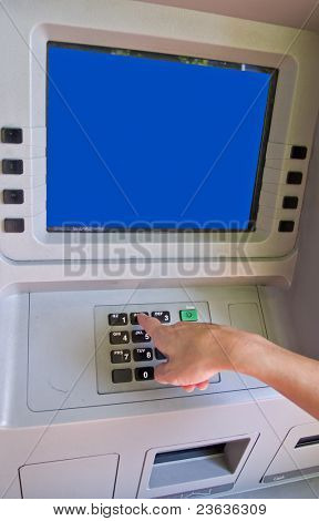Woman accessing Automatic Teller Machine (ATM) on the street
