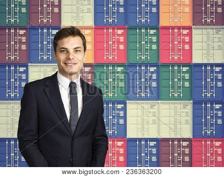 smiling businessman and colorful cargo container