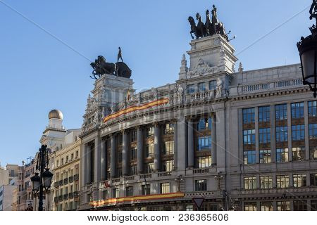 Madrid, Spain - January 22, 2018: Building With Sculpture Of A Chariot At Alcala Street In City Of M